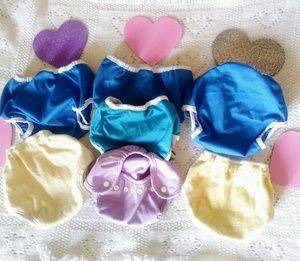 Lot of seven S and XS diaper covers